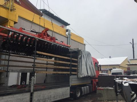 Unloading agricultural machines before the EuroAgro Lviv - the International Agricultural Fair