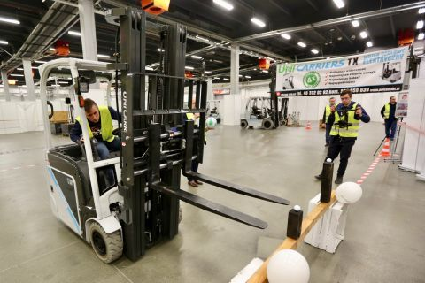 "The forklift operators' competition struggles was staged in the ""G"" expo hall of Targi Kielce exhibition and congress centre"