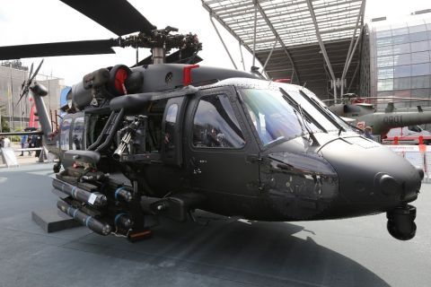 An S-70i Black Hawk helicopter at the MSPO trade show carries a lightweight  single-station external stores pylon supporting four Hellfire air-to-ground missiles.  The prototype pylon's drop design offers a  wide field of fire to the crew-served machine g